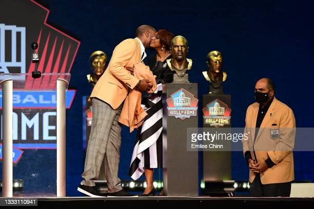 Charles Woodson shares a moment with his mother Georgia Woodson after unveiling his bust during the NFL Hall of Fame Enshrinement Ceremony at Tom...