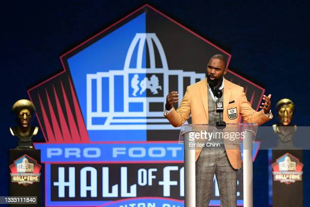 Charles Woodson sings to his mother Georgia Woodson during the NFL Hall of Fame Enshrinement Ceremony at Tom Benson Hall Of Fame Stadium on August...
