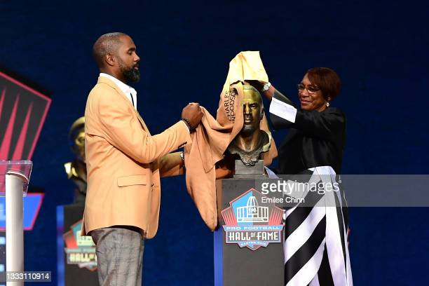 Charles Woodson unveils his bust with his mother Georgia Woodson during the NFL Hall of Fame Enshrinement Ceremony at Tom Benson Hall Of Fame Stadium...