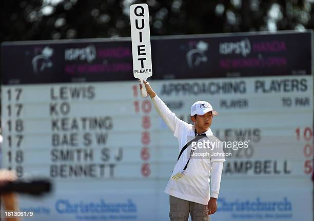 Charles Zhang 11 years old of Christchurch with a 'Quiet Please' sign during day three of the New Zealand Women's Golf Open at Clearwater Golf Course...