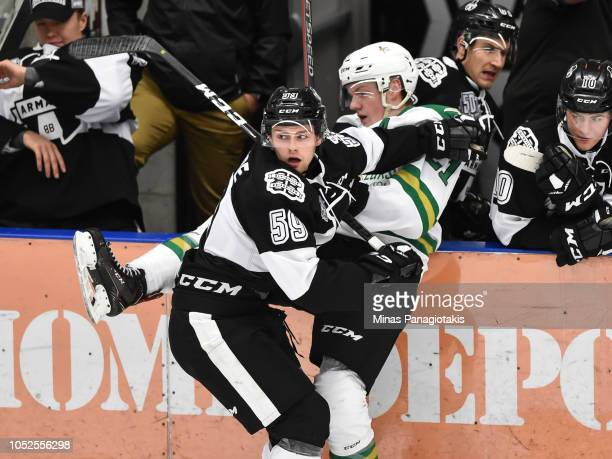 CharlesAntoine Giguere of the BlainvilleBoisbriand Armada checks Maxence Guenette of the ValdOr Foreurs during the QMJHL game at Centre d'Excellence...