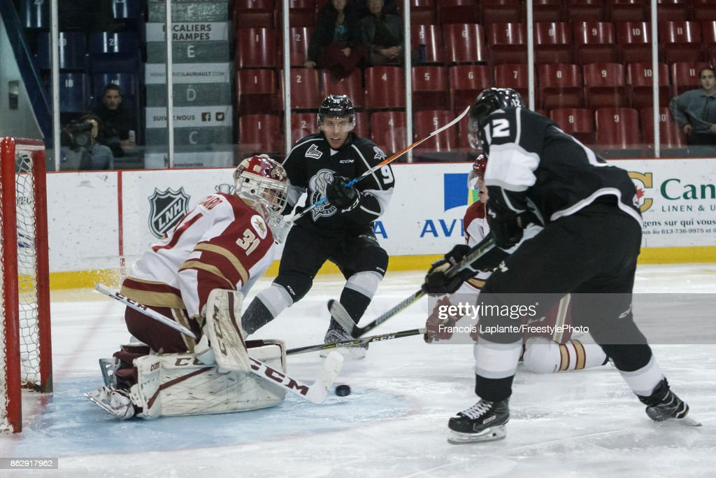 Charles-Antoine Roy #12 of the Gatineau Olympiques battles for a rebound as Reilly Pickard #31 of the Acadie-Bathurst Titan guards his net on October 18, 2017 at Robert Guertin Arena in Gatineau, Quebec, Canada.