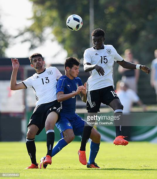 CharlesJesaja Herrmann and Goerkem Can of Germany and Pietro Pellegri of Italy vie for the ball during the Under 17 four nations tournament match...