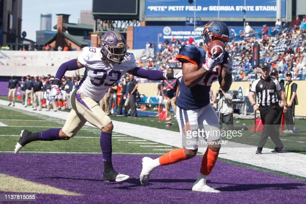 Charles Johnson of the Orlando Apollos catches a touchdown pass during the fourth quarter against Donatello Brown of the Atlanta Legends in an...