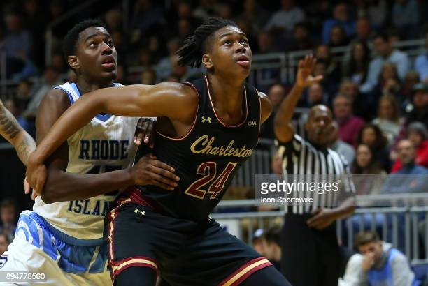 Charleston Cougars forward Jaylen McManus and Rhode Island Rams forward Nicola Akele battle for position during a college basketball game between...