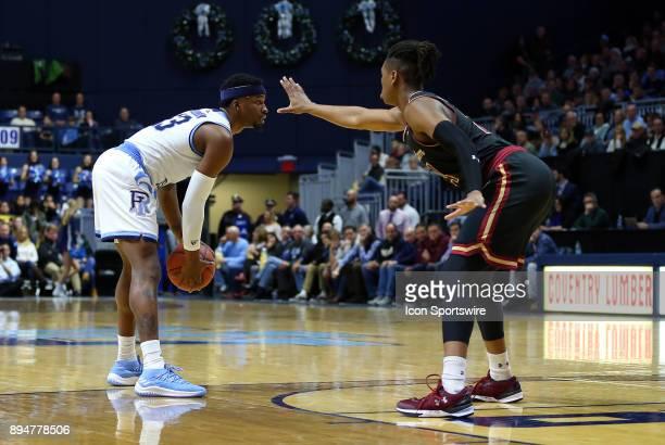Charleston Cougars forward Jaylen McManus defends Rhode Island Rams guard Stanford Robinson during a college basketball game between Charleston...