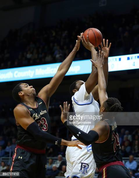 Charleston Cougars forward Nick Harris and Charleston Cougars forward Jaylen McManus defends Rhode Island Rams forward Andre Berry during a college...