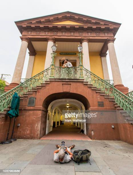 Charleston professional photographer Justin Falk foreground photographs newlyweds Kathryn and Anthony Palmisano on the steps of the Charleston City...