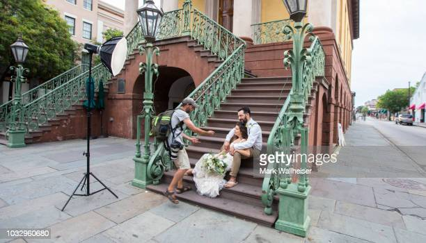 Charleston professional photographer Justin Falk left photographs newlyweds Kathryn and Anthony Palmisano on the steps of the Charleston City Market...