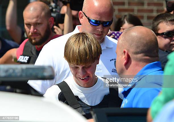 Charleston shooting suspect Dylann Roof is escorted from the Shelby Police Dept Thursday June 18 2015 in Shelby SC