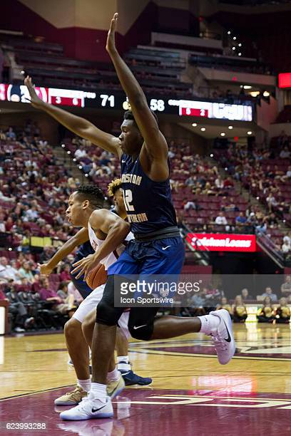 Charleston Southern forward Antwan Maxwell Jr guarding Florida State guard CJ Walker during the NCAA basketball game between the Florida State...