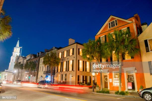 charleston street traffic motion blurred at night south carolina - charleston south carolina stock photos and pictures