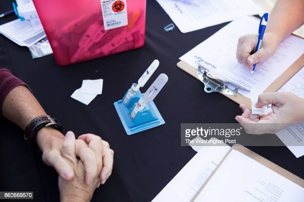 Charleston West Virginia September 28 A patient fills out a form while her blood and saliva are screened for Hepatitis C and HIV in the rural town of...