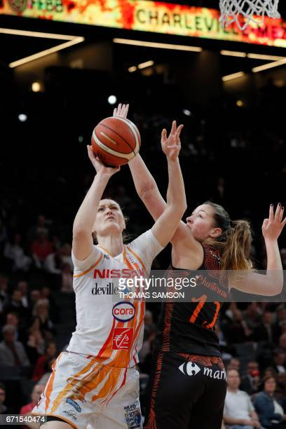 Charlevilles' Valeriya Berezhynska of France vies with Bourges' Alexia Chartereau of France during the women's French basketball cup ProA final match...