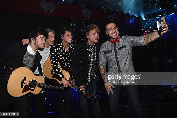 Charley Bagnall Jake Roche Lewi Morgan and Danny Wilkin of Rixton pose backstage with Mo' Bounce at iHeartRadio Jingle Ball 2014 hosted by Z100 New...