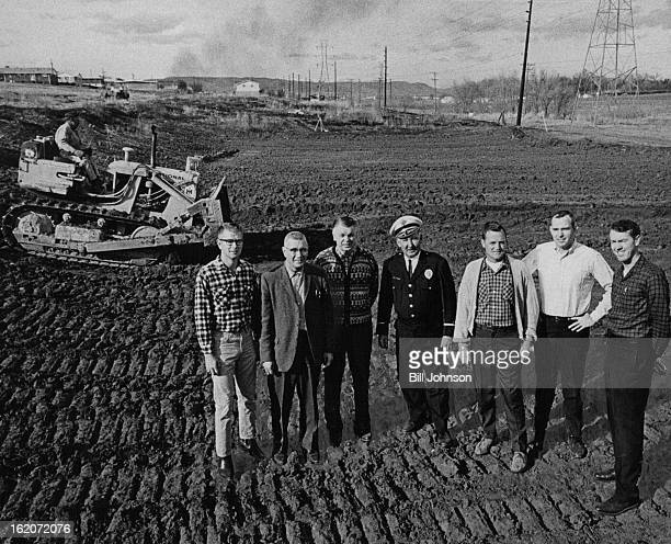 NOV 20 1965 NOV 22 1965 Charley Gieseker Drives Caterpillar to Level Land for ice Skating Rink With him are Jim Frantz and George A Sperry of the...