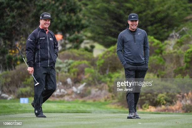 Charley Hoffman and Keith Mitchell laugh together while walking on the fifth hole tee box during the second round of the ATT Pebble Beach ProAm at...
