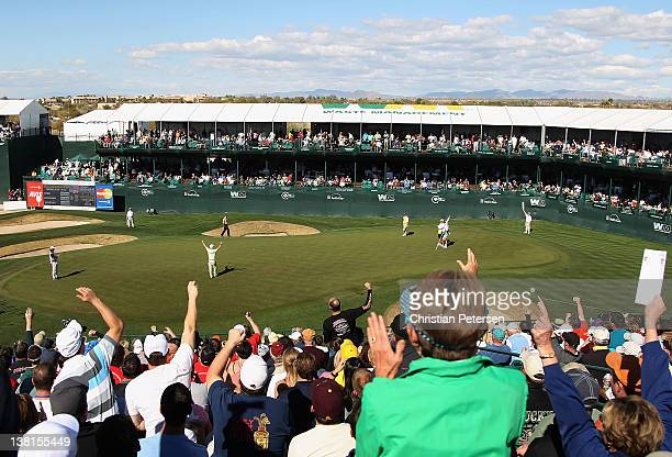Charley Hoffman celebrates after making a par putt on the 16th hole green during the second round of the Waste Management Phoenix Open at TPC...