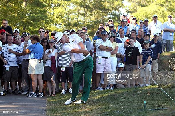 Charley Hoffman hits a shot off the cart path on the 14th hole during the final round of the Deutsche Bank Championship at TPC Boston on September 6,...