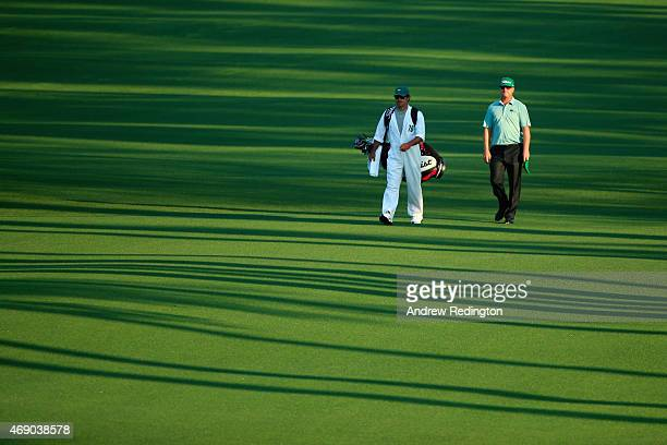 Charley Hoffman of the United States and his caddie Brett Waldman walk to the second green during the first round of the 2015 Masters Tournament at...