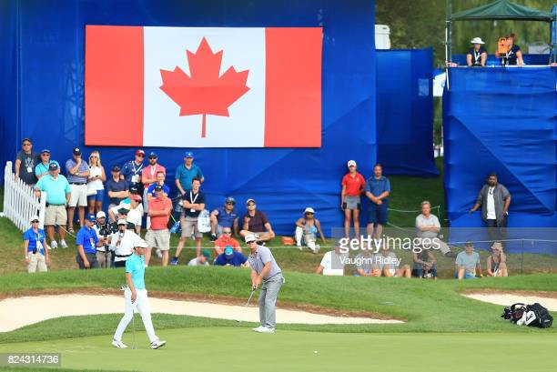 Charley Hoffman of the United States and Ryan Ruffels of Australia putt on the 18th green during the third round of the RBC Canadian Open at Glen...