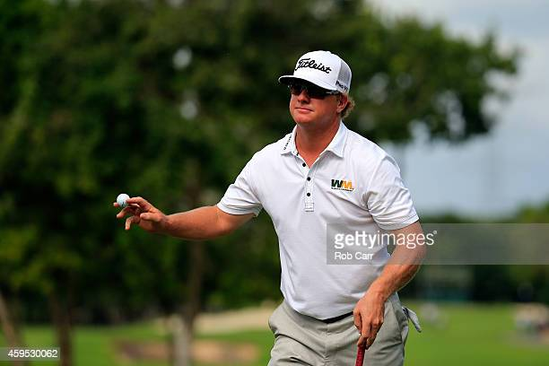 Charley Hoffman of the United States celebrates after putting out on the 9th green during the final round of the OHL Classic at the Mayakoba El...