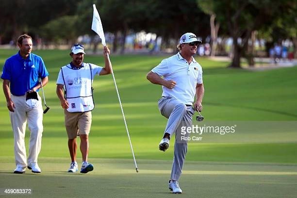 Charley Hoffman of the United States celebrates as Shawn Stefani looks on after putting out on the 18th hole to win the final round of the OHL...