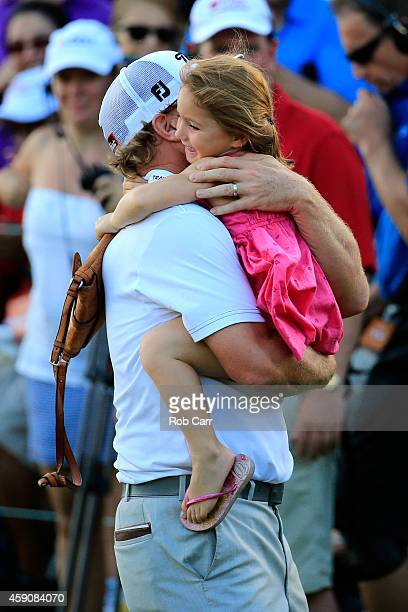 Charley Hoffman of the United States celebrates with his daughter Claire after putting out on the 18th hole to win the final round of the OHL Classic...