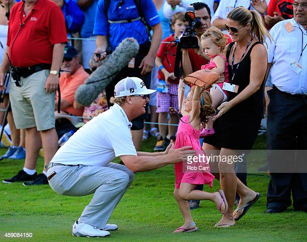 Charley Hoffman of the United States celebrates with his family after putting out on the 18th hole to win the final round of the OHL Classic at the...