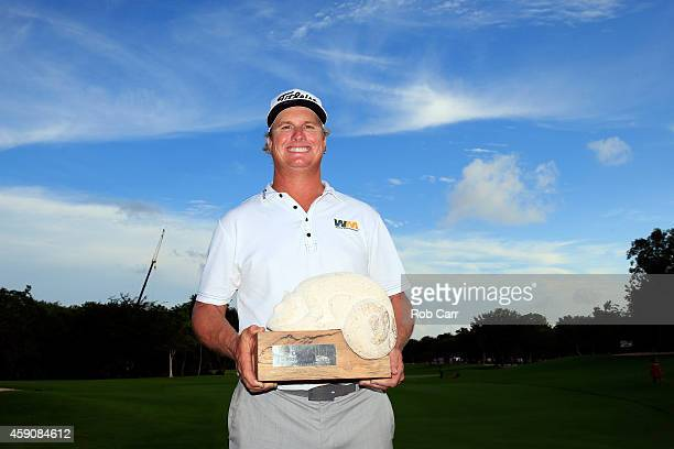 Charley Hoffman of the United States celebrates with the trophy after winning the final round of the OHL Classic at the Mayakoba El Camaleon Golf...