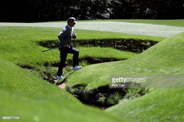Charley Hoffman of the United States jogs up the 13th fairway during the second round of the 2017 Masters Tournament at Augusta National Golf Club on...