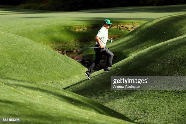Charley Hoffman of the United States jogs up the 13th hole during the first round of the 2017 Masters Tournament at Augusta National Golf Club on...
