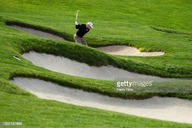 Charley Hoffman of the United States plays a shot from a bunker on the sixth hole during the final round of the AT&T Pebble Beach Pro-Am at Pebble...