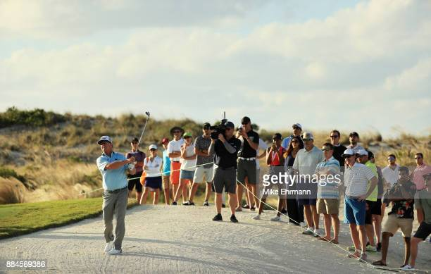 Charley Hoffman of the United States plays a shot on the 14th hole during the third round of the Hero World Challenge at Albany Bahamas on December 2...