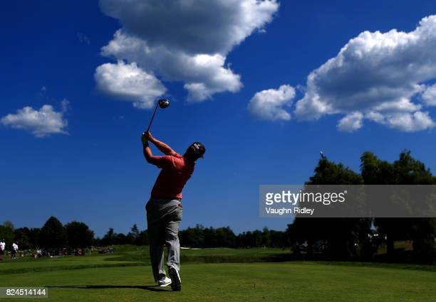 Charley Hoffman of the United States plays his shot from the eighth tee during the final round of the RBC Canadian Open at Glen Abbey Golf Club on...