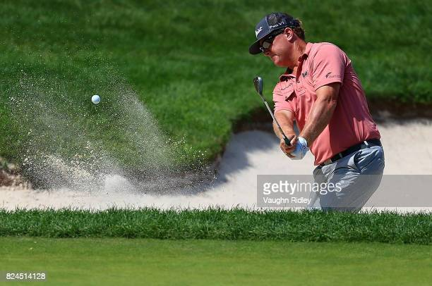 Charley Hoffman of the United States plays his shot out of the bunker on the ninth hole during the final round of the RBC Canadian Open at Glen Abbey...