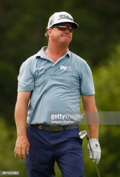 Charley Hoffman of the United States reacts after his shot on the 16th hole during the third round of the 2017 US Open at Erin Hills on June 17 2017...