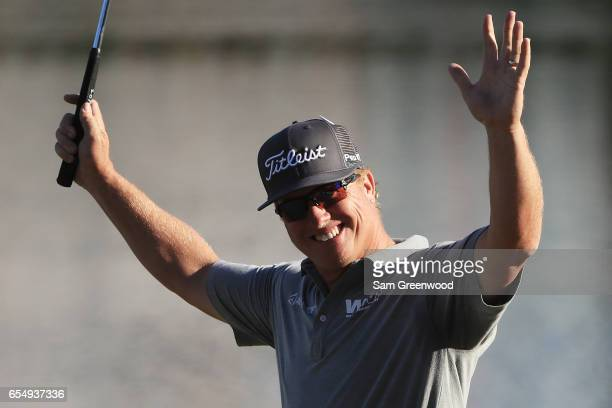 Charley Hoffman of the United States reacts after putting for birdie on the 18th green during the third round of the Arnold Palmer Invitational...