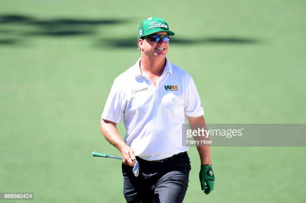 Charley Hoffman of the United States reacts to a chip on the second hole during the final round of the 2017 Masters Tournament at Augusta National...