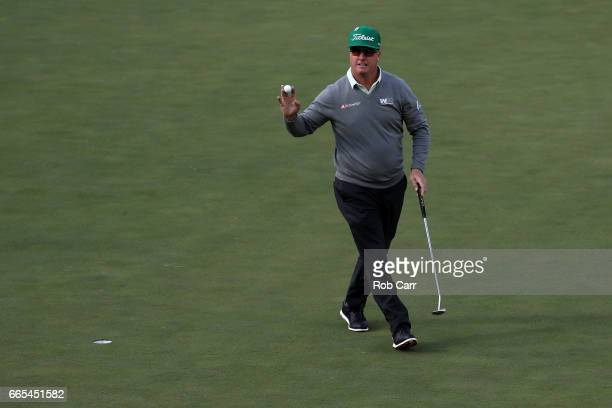 Charley Hoffman of the United States reacts to a putt for birdie on the 15th hole during the first round of the 2017 Masters Tournament at Augusta...