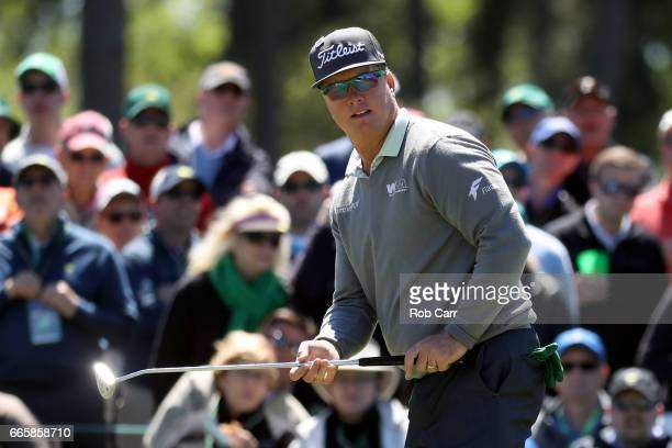 Charley Hoffman of the United States reacts to his putt on the ninth hole during the second round of the 2017 Masters Tournament at Augusta National...