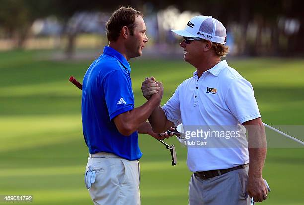 Charley Hoffman of the United States shakes hands with Shawn Stefani on the 18th hole after winning the final round of the OHL Classic at the...