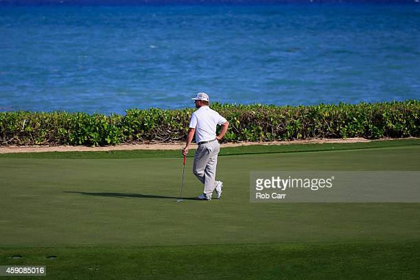 Charley Hoffman of the United States waits to putt on the 15th green during the final round of the OHL Classic at the Mayakoba El Camaleon Golf Club...