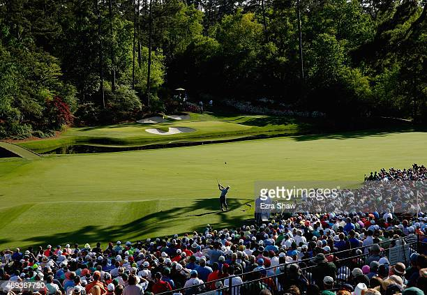 Charley Hoffman of the United States watches his tee shot on the 12th hole during the third round of the 2015 Masters Tournament at Augusta National...