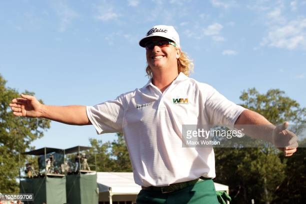 Charley Hoffman reacts as he goes to hug his wife after a birdie on the 18th hole during the final round of the Deutsche Bank Championship at TPC...