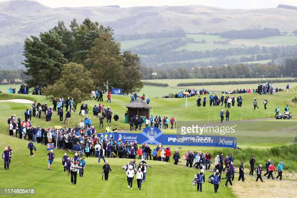 Charley Hull and Azahara Munoz of Team Europe walk on the fourth hole during Day 2 of the Solheim Cup at Gleneagles on September 14, 2019 in...