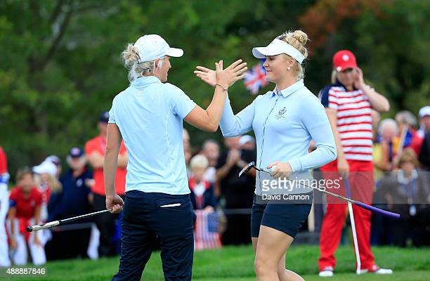Charley Hull and Melissa Reid of the European Team celebrate a 21 win against Brittany Lincicome and Michelle Wie of the United States on the 17th...