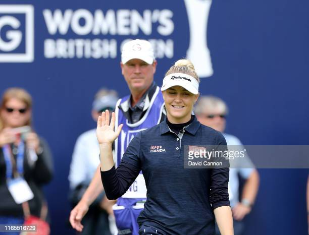 Charley Hull of England acknowledges the crowds after making a birdie putt on the 18th hole during Day One of the AIG Women's British Open on the...
