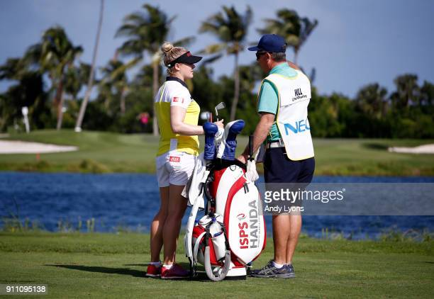 Charley Hull of England and her caddie talk on the tee of the third hole during the second round of the Pure Silk Bahamas LPGA Classic at the Ocean...