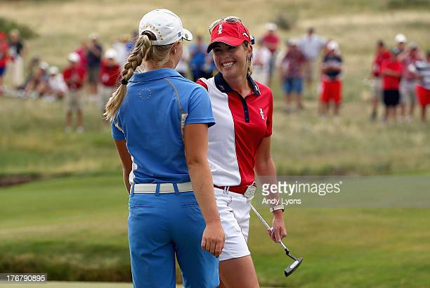 Charley Hull of England and the European Solheim Cup Team and Paula Creamer of the USA Solheim Cup Team hug after Hull won their match during the...